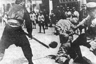 Chiang's troops execute a communist worker, Shanghai, 1927.