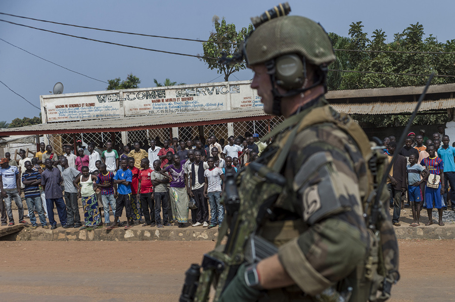 A French soldier stands guard at a checkpoint in Combattant neighborhood near Bangui's airport, on December 9, 2013