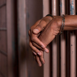 black-man-in-handcuffs-in-jail