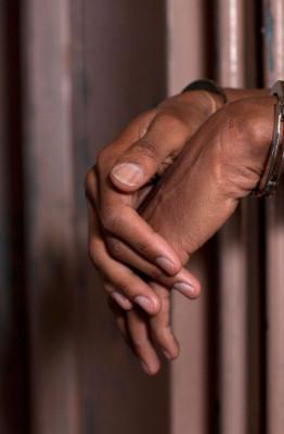 black-man-in-handcuffs-in-jail