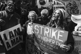 Fast food workers strike for a living wage.