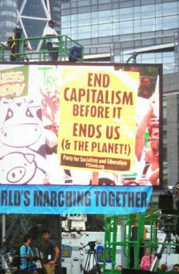 PSL signs at the People's Climate March