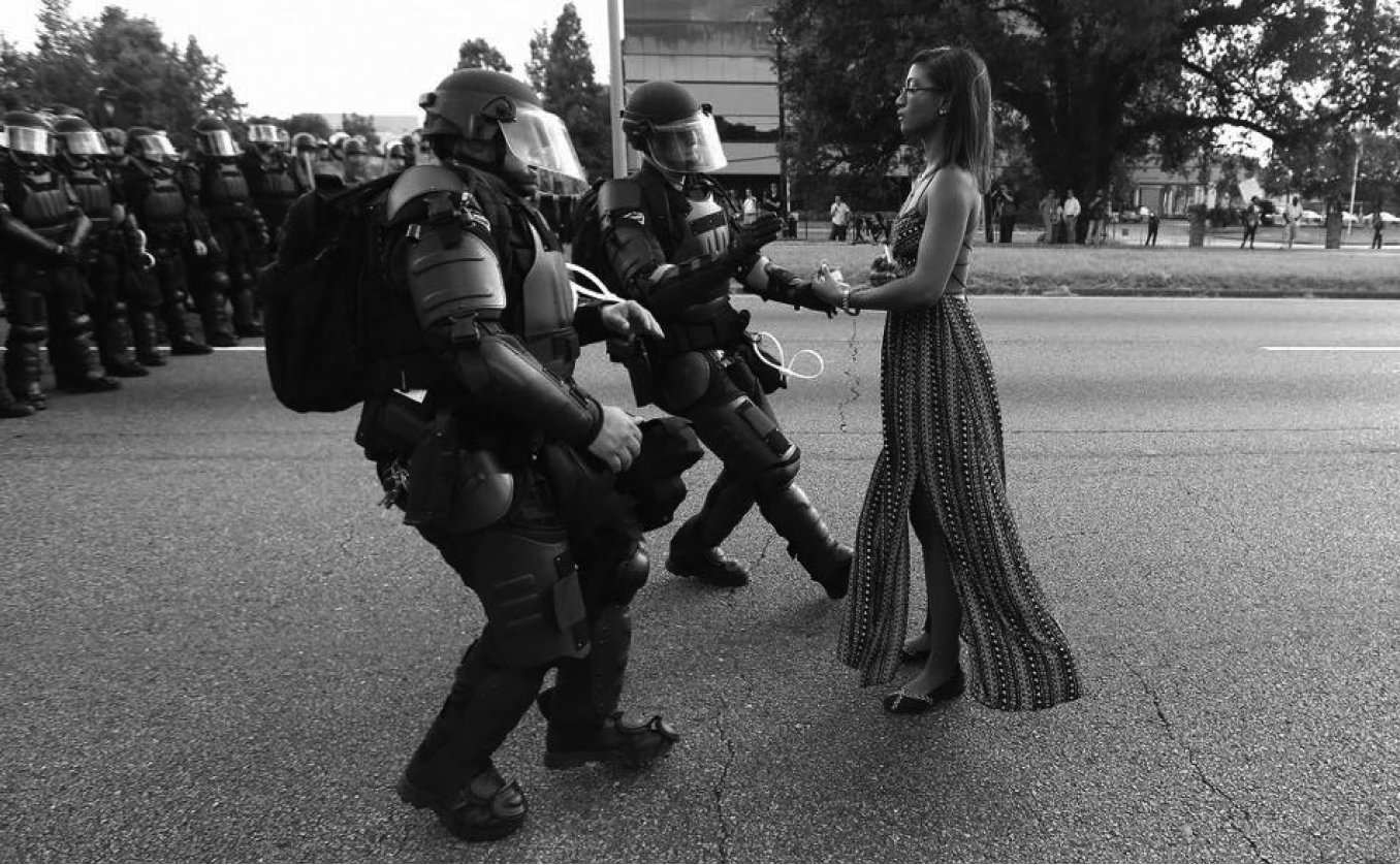 Ieshia Evans refuses to disperse and stands up to militarized police in Baton Rouge after the lynching of Alton Sterling. Photo: Jonathan Bachman