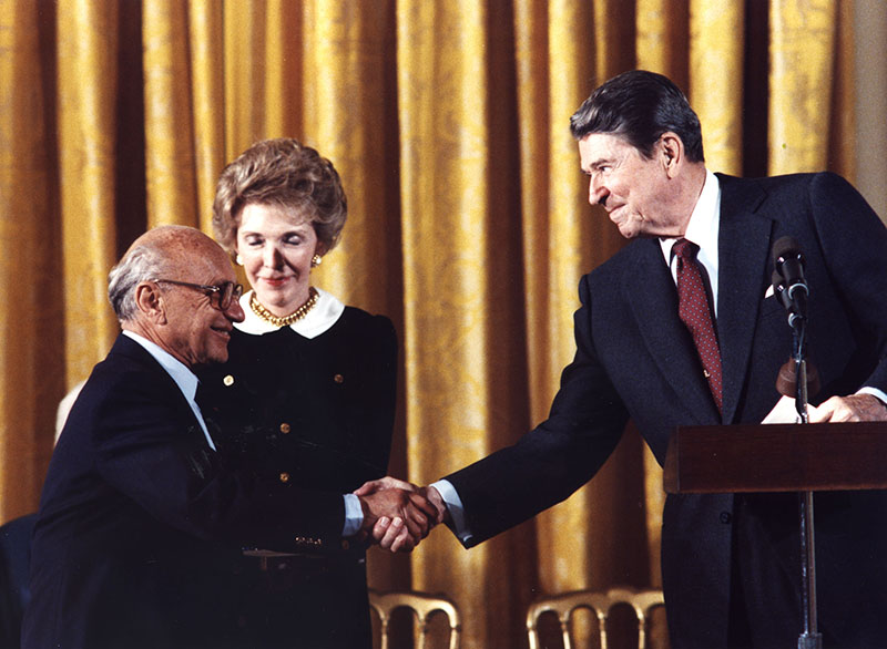 Bourgeois ideologue Milton Friedman with Ronald Reagan