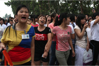 Workers demonstrate outside the Honda factory in Zhongshan, China.