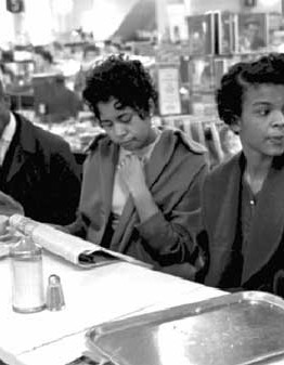 Students from a local North Carolina college sit in at a whites-only lunch counter. Many brought books and newspapers to emphasize the seriousness of their intentions. Photo: Norton