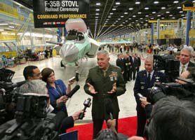 The military-industrial complex creates a revolving door where retired Pentagon officers get jobs with arms contractors. Here, a Marine Corps general promotes Lockheed Martin's weaponry. Photo: Rodger Mallison