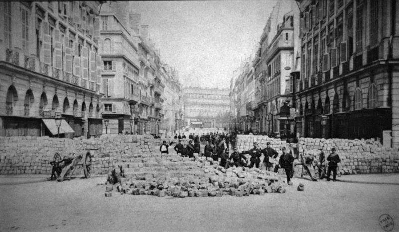 A barricade during The Paris Commune, 1871. Source: Wikimedia Commons.