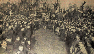 "In this 1919 photo from Frimu's funeral, the people gather under the banner reading ""Down with the assassins of Frimu!"""