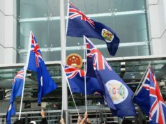 Hong Kong protesters wave the Hong Kong colonial flag